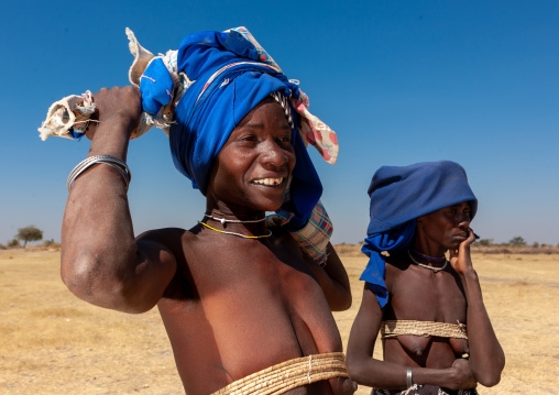 Mucubal tribe women wearing blue headwears, Namibe Province, Virei, Angola