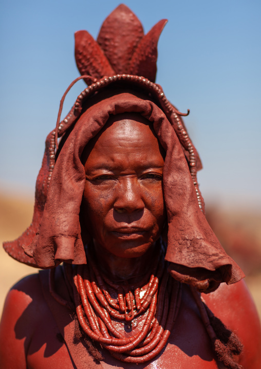 Portrait of a Himba tribe woman covered with otjize, Cunene Province, Oncocua, Angola