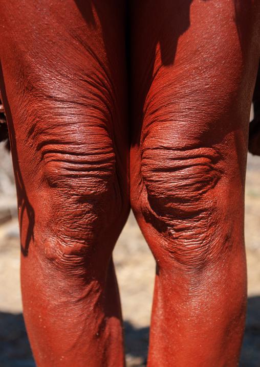 Himba tribe woman legs cvered with otjize, Cunene Province, Oncocua, Angola