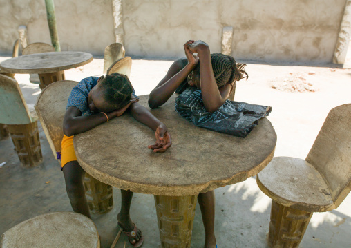 Angolan girls sleeping on a table restaurant, Namibe Province, Namibe, Angola
