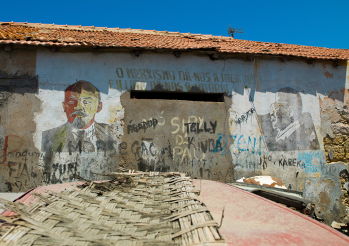 Old communist propaganda painted on a wall with lenin and jose eduardo dos santos, Namibe Province, Namibe, Angola