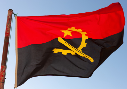 Angolan flag in the wind, Namibe Province, Tombua, Angola