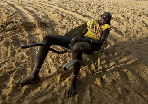 Mucubal Boy Sleeping In A Wheelbarrow, Virie Area, Angola