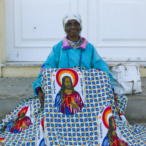 Woman With Headband Selling A Loincloth Decorated With The Head Of Jesus, Namibe Town, Angola