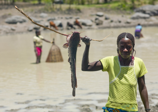 Woman Showing The Fish She Caught In The River, Angola