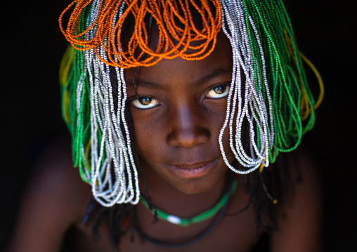 Muhakaona tribe girl with a beaded wig used for the fico ceremony, Cunene Province, Oncocua, Angola