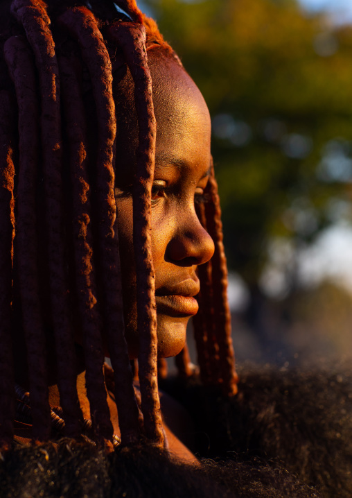 Himba tribe woman face in the sun, Cunene Province, Oncocua, Angola