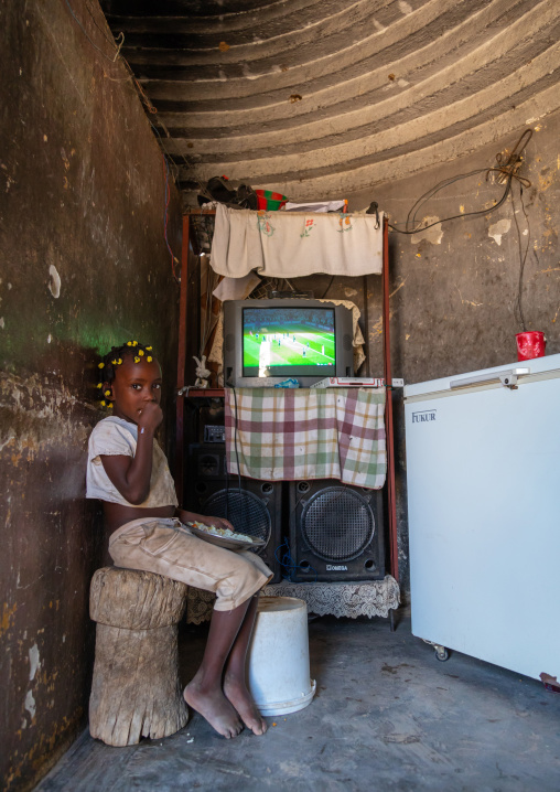 Angolan girl living in an experimental house for the local people built by the portuguese, Namibe Province, Caraculo, Angola