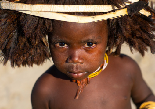 Cute mucubal tribe boy wearing a fur headwear, Namibe Province, Virei, Angola