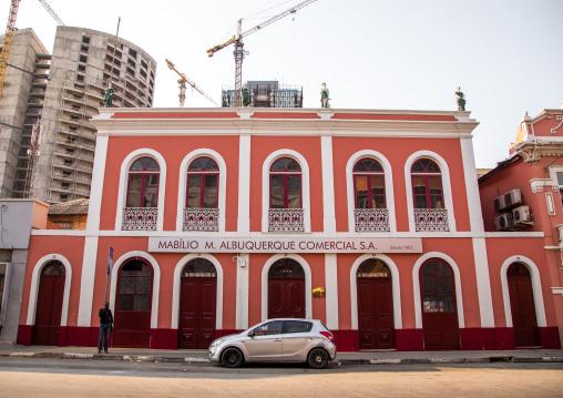 Old portuguese colonial building in front of a new skyscraper, Luanda Province, Luanda, Angola
