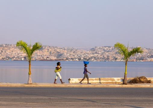Angolan women walking along the seashore, Benguela Province, Lobito, Angola