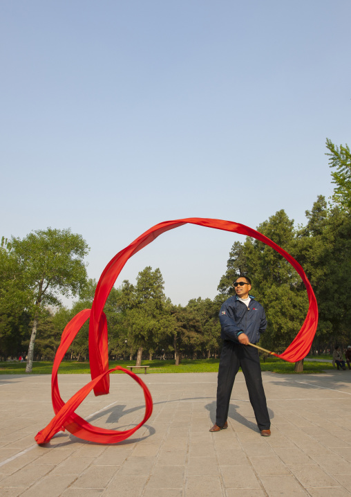 Man Doing Gymnastic With Ribbons In A Park, Beijing, China