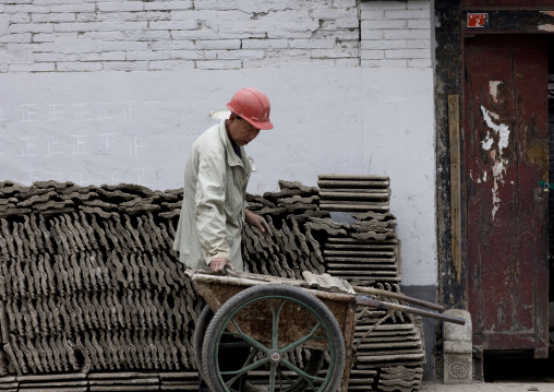 Manual Worker On A Contruction Site, Beijing, China