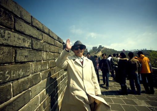 Chinese Old Man Saluting On The Great Wall, Beijing, China