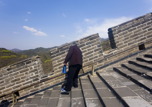 Old Woman Going Down The Great Wall, Beijing, China