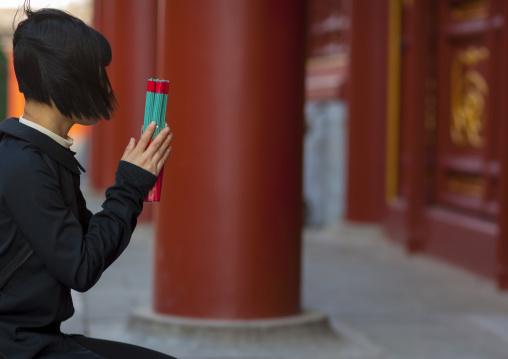 Woman Praying At Lama Temple, Beijing, China