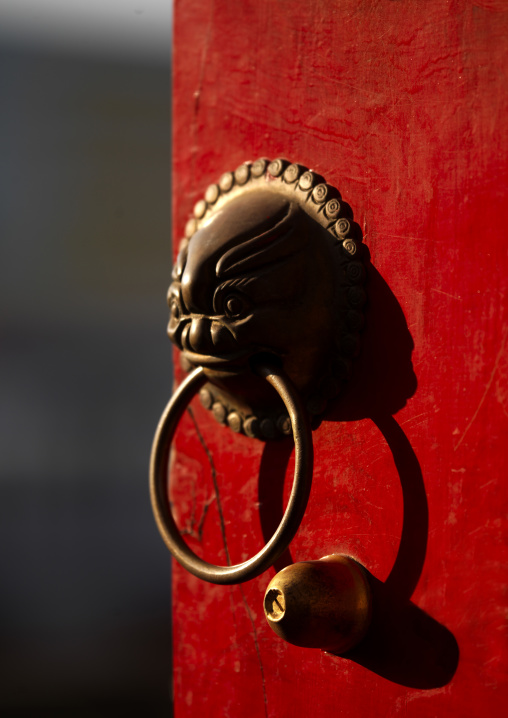 Painted Door With Lion Door Knocker In Chaoyang Tower City Gate, Ancient Town, Jianshui, Yunnan Province, China