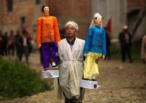 Man Holding Puppets During A Funeral Procession, Yuanyang, Yunnan Province, China