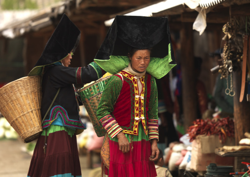 Yi Tribal Women In Traditional Clothes In A Market, Yongning, Yunnan Province, China