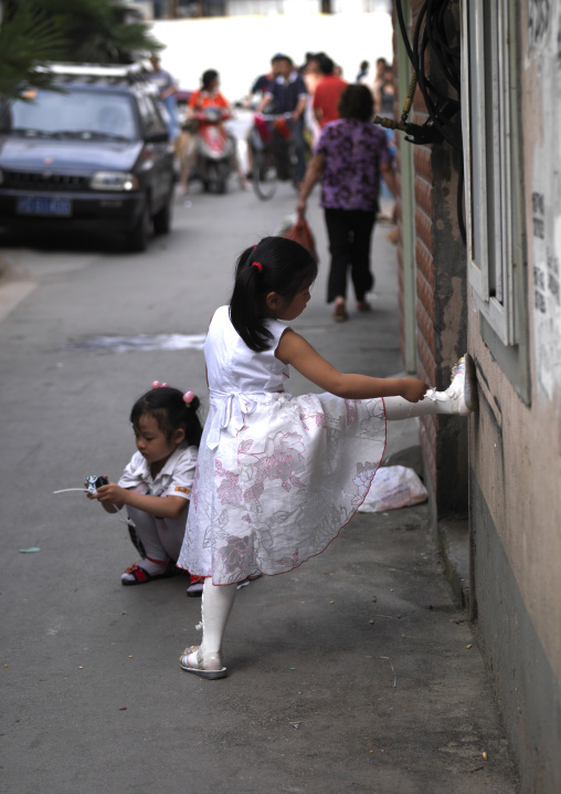 Kids Playing In The Street, Shangai, China