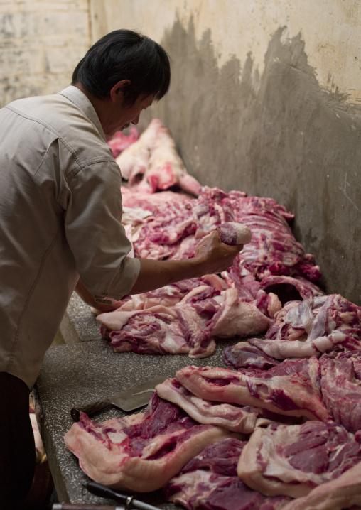 Butcher During Wedding Meal Preparations, Tuan Shan Village, Yunnan Province, China