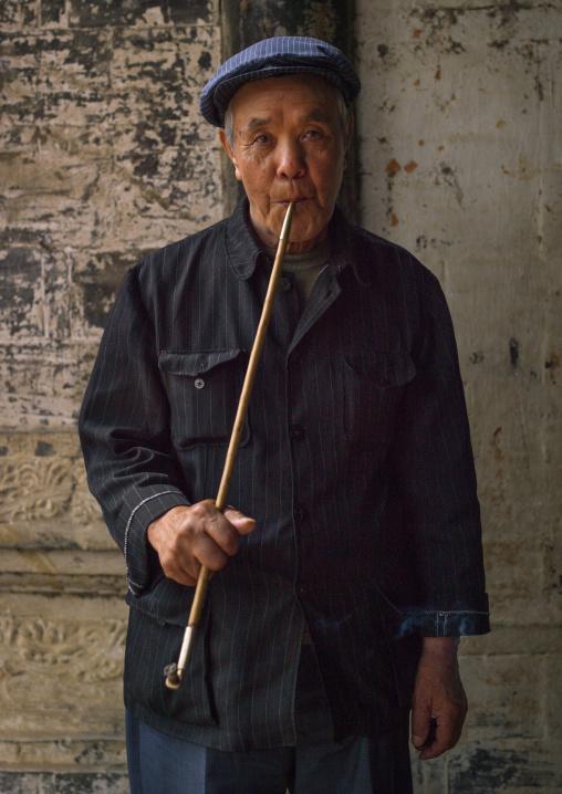 Old Man Smoking A Long Pipe, Tuan Shan Village, Yunnan Province, China