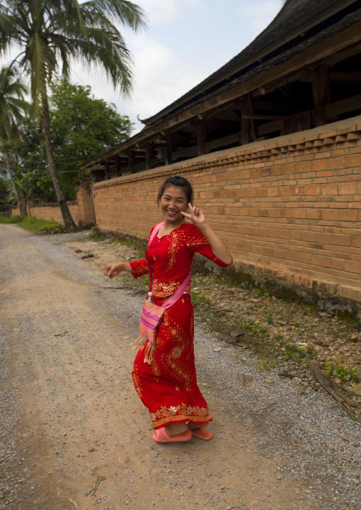 Dai Woman Making V Sign, Galamba, Xishuangbanna Region, Yunnan Province, China