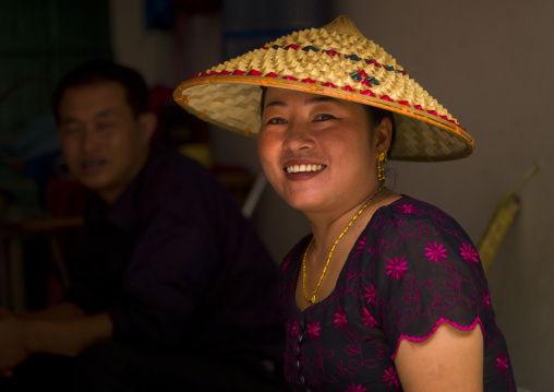 Woman With A Chinese Hat, Menglun, China