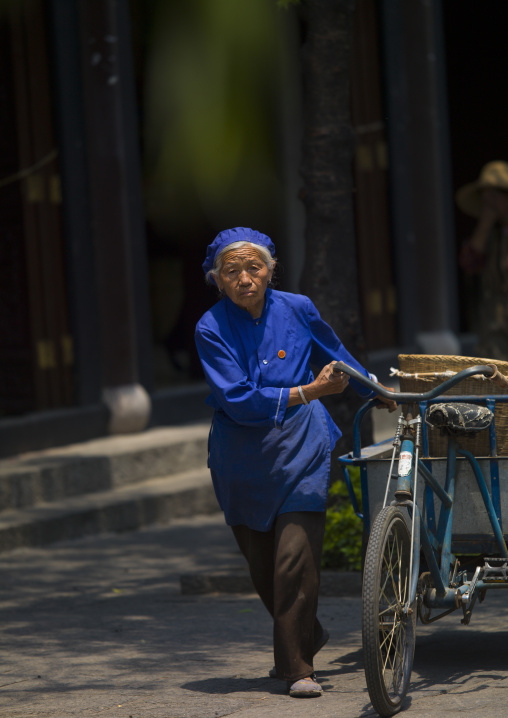 Old Woman With A Bicycle In A Street, Dali, Yunnan Province, China