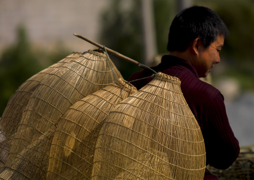 Woman With A Fishing Nets On His Back, Shaxi, Yunnan Province, China