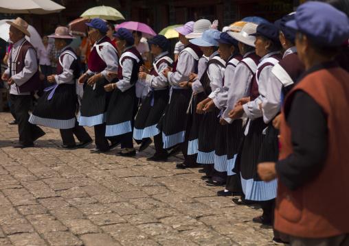 Naxi Minority Women Dancing, Lijiang, Yunnan Province, China