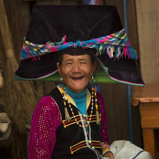 Yi Tribal Woman In Traditional Clothes, Yongsheng, Yunnan Province, China