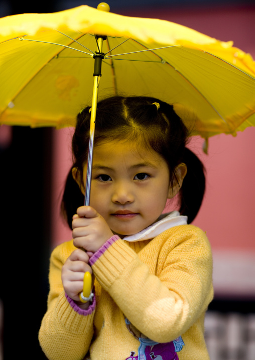 Chinese Girl With A Yellow Umbrella, Beijing, China