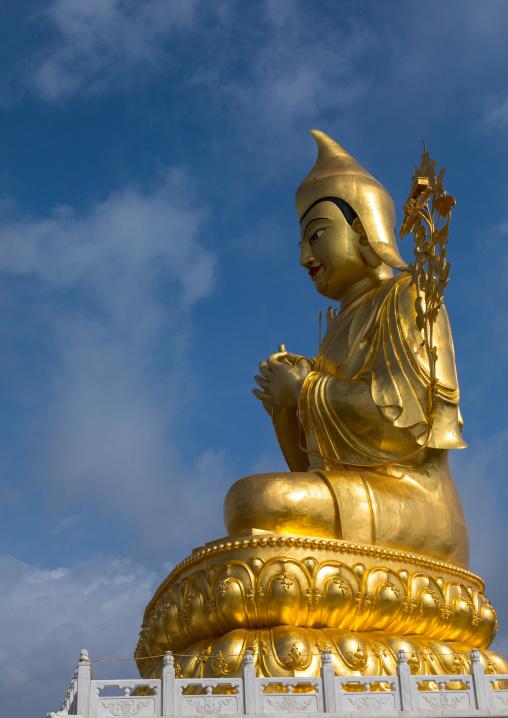 Golden statue of buddha in Shachong monastery, Qinghai Province, Wayaotai, China