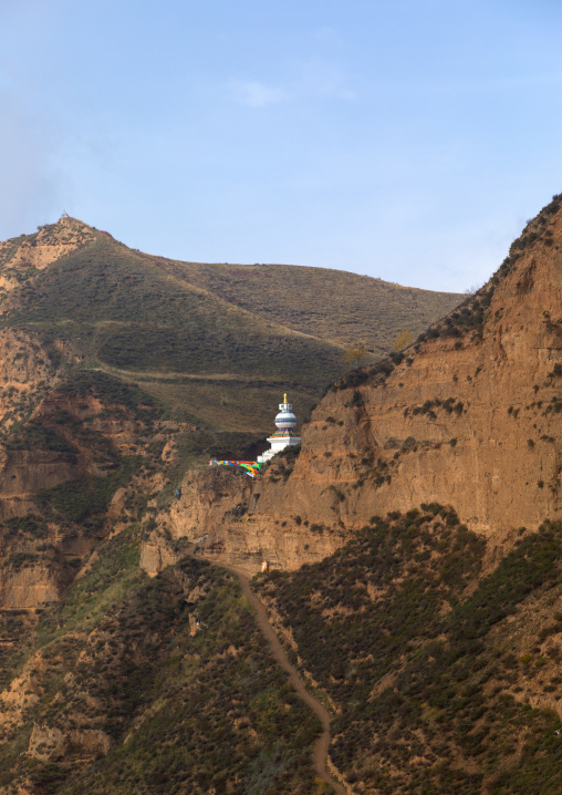 Stupa on a cliff in Shachong monastery, Qinghai Province, Wayaotai, China