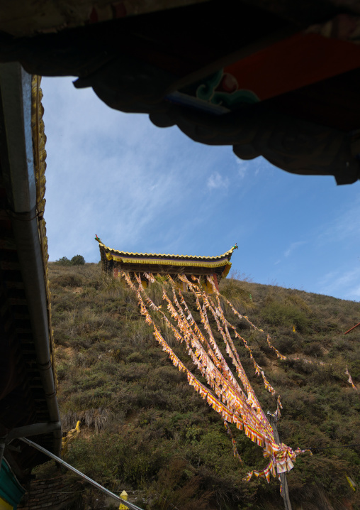 Prayer flags in on a hil in Shachong monastery, Qinghai Province, Wayaotai, China
