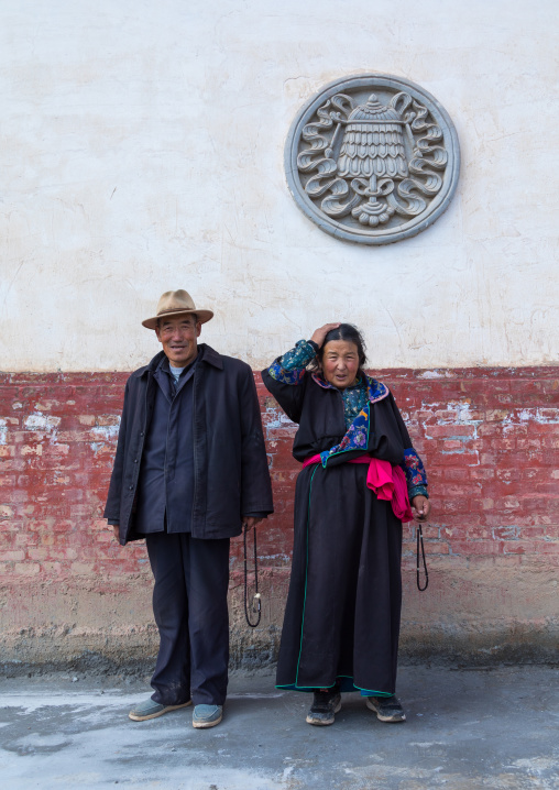 Tibetan couple in traditional clothing in Shachong monastery, Qinghai Province, Wayaotai, China
