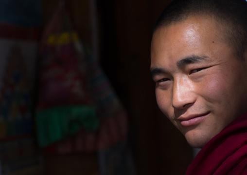 Portrait of a tibetan monk in wutun si monastery, Qinghai province, Wutun, China
