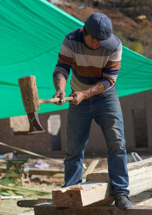Tibetan carpenters building a new wooden house, Tongren County, Rebkong, China