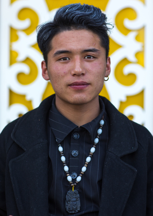 Portrait of young and fashionnable tibetan man, Tongren County, Rebkong, China