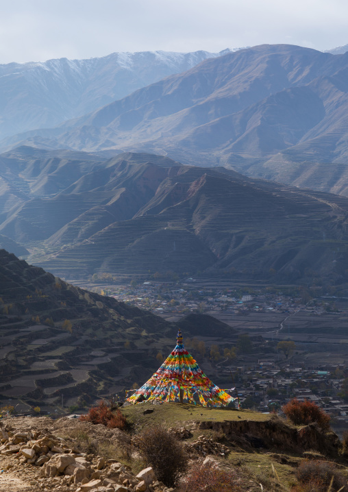 Prayer flags over the mountain in Chonjgon monastery, Tongren County, Longwu, China
