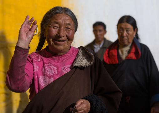 Pilgrim tibetan pilgrims walking the kora around Rongwo monastery, Tongren County, Longwu, China