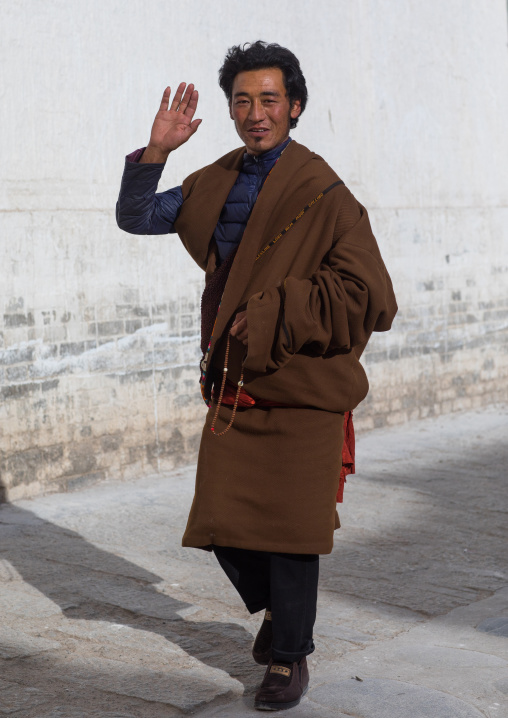 Tibetan man in Rongwo monastery, Tongren County, Longwu, China
