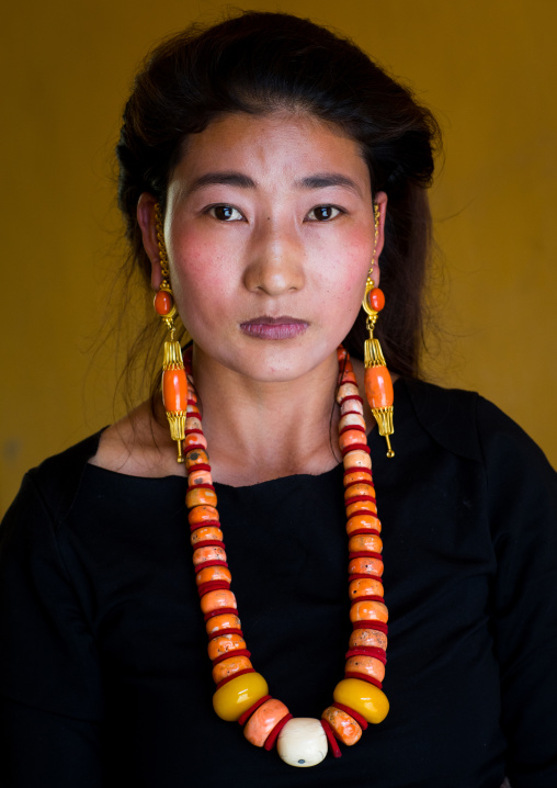 Portrait of a tibetan woman with a huge necklace, Qinghai province, Tsekhog, China