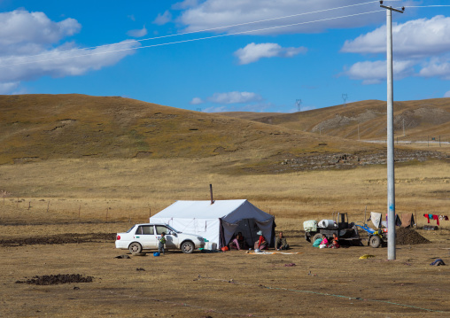 Tibetan nomad family living in a tent in the grasslands, Qinghai province, Tsekhog, China