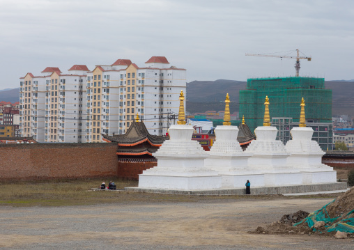 Stupas in front of the modern town in Hezuo monastery, Gansu province, Hezuo, China