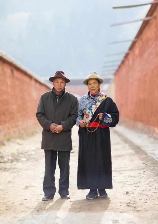 Tibetan couple in Labrang monastery street, Gansu province, Labrang, China