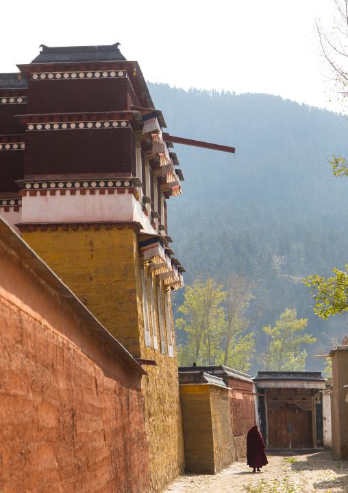Tibetan monk in the Labrang monastery street, Gansu province, Labrang, China