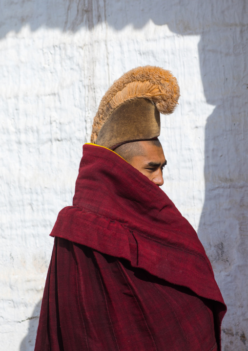 Portrait of a tibetan monk wearing robe and yellow hat of the gelug order or yellow hat sect in Labrang monastery, Gansu province, Labrang, China