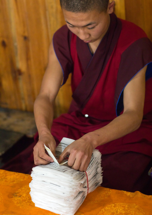 Tibetan scriptures printed from wooden blocks and packed in the monastery traditional printing temple, Gansu province, Labrang, China